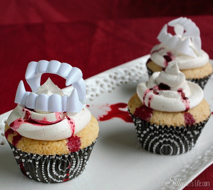 Vampire Kiss Cupcakes made from Vanilla Cupcakes with Vanilla Bean Buttercream recipe on https://ThisSillyGirlsLife.com #VampireCupcake #HalloweenTreats #VanillaCupcake #Vanilla #Buttercream