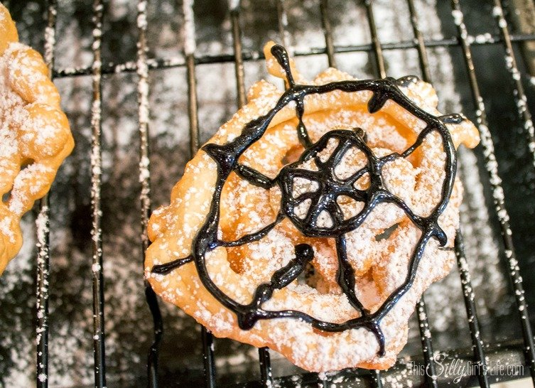 Crispy Spider Webs {Mini Funnel Cakes} perfect for a Halloween party or a treat before the little ones go trick or treating! Recipe from http://ThisSillyGirlsLife.com #Halloween #SpiderWeb #SpiderTreats #FunnelCakes #Mini