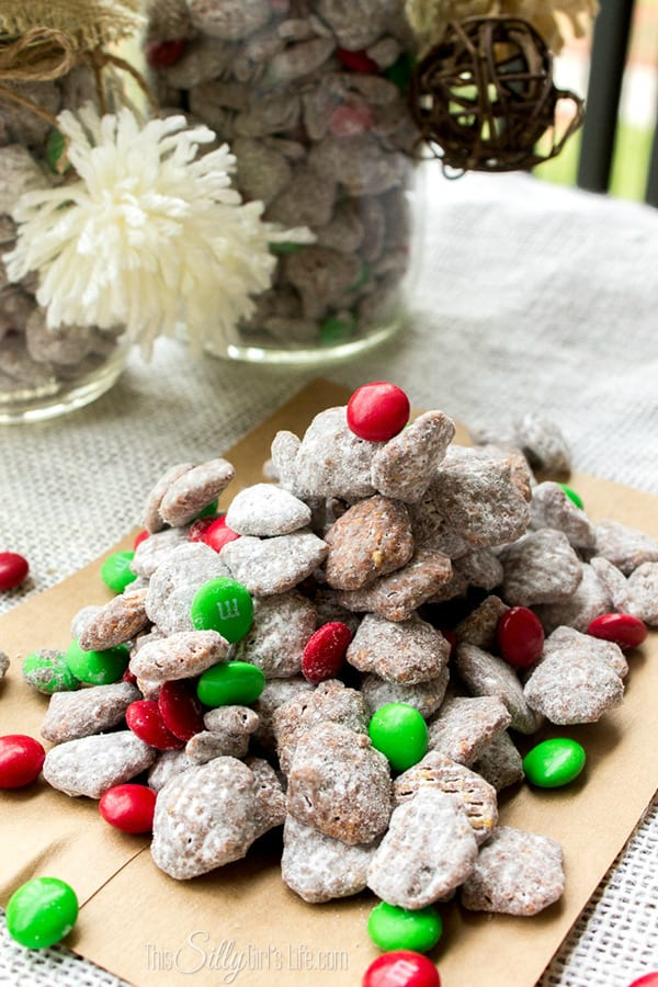 Reindeer Chow, commonly known as muddy buddies but with a fun holiday twist! Chocolate and peanut butter coated crispy cereal, tossed in powdered sugar. Seriously the best snack ever!