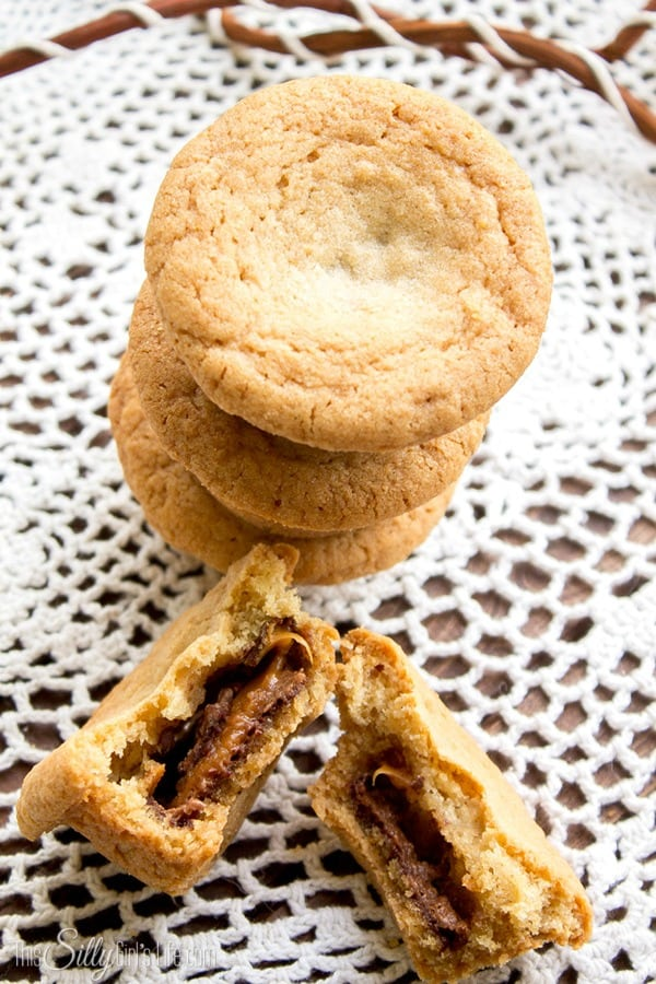 Milky Way Stuffed Cookie Cups recipe, crispy yet soft sugar cookie like outer cookie stuffed with warm and gooey milky way bars. A must try with easy to follow step by step directions!