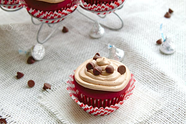 Chocolate Stuffed Red Velvet Cupcakes with Nutella Frosting, stuffed with a little Hershey's kiss and topped with buttercream flavored with nutella... woah!