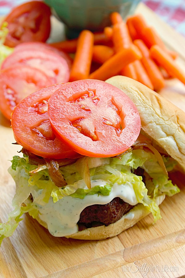 Double Ranch Stuffed Burgers, juicy burgers stuffed with ranch flavored cream cheese, grilled and topped with homemade ranch sauce and more goodies! #SayCheeseburger #shop