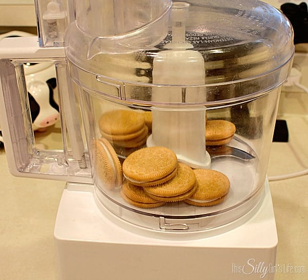 Preheat oven to 350 degrees. Place half the golden oreos in a food processor.