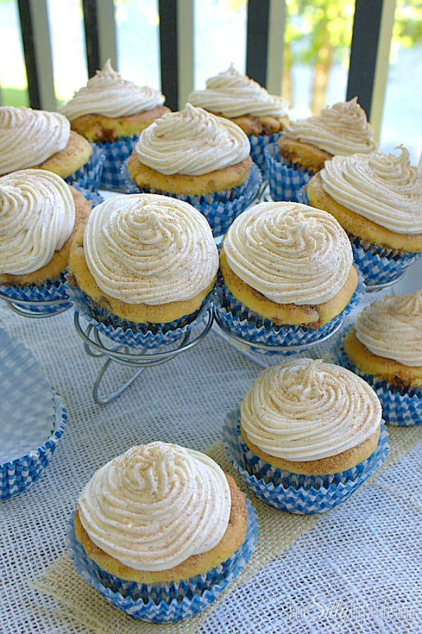 Cinnamon Sugar Cupcakes, yellow cake studded with cinnamon chips, brushed with butter and rolled in cinnamon sugar, topped with the BEST cream frosting!