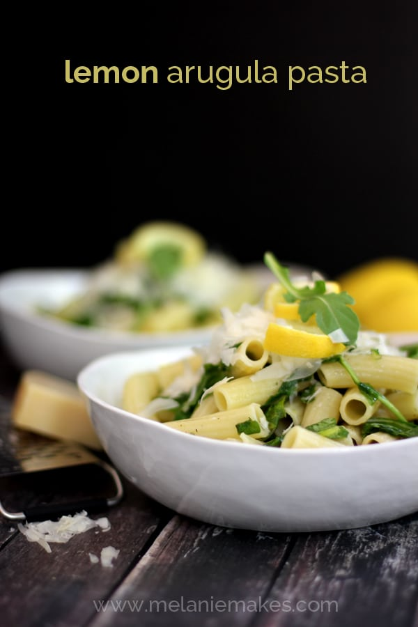 Lemon Arugula Pasta, Your favorite pasta is tossed with lemon juice and zest as well as arugula and olive oil and then topped with a shower of shredded Parmesan cheese.