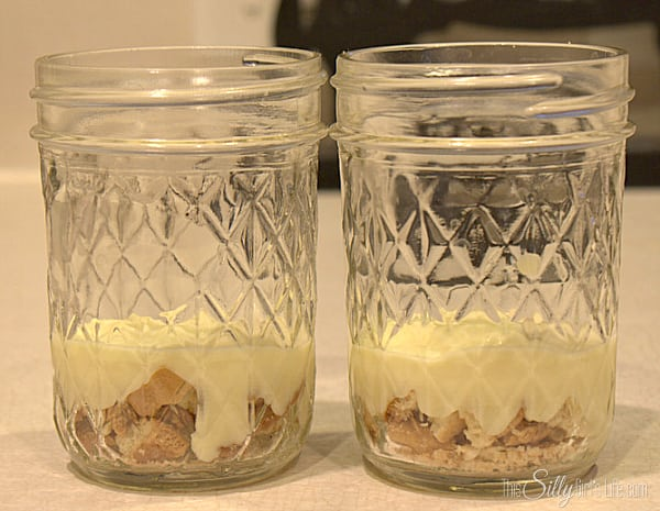 Make pudding according to directions on the back of the box. In a bowl, place half of the pudding and half of the whipped topping. Fold together until combined. In medium sized mason jar, layer the vanilla wafer crumbs and the banana pudding.