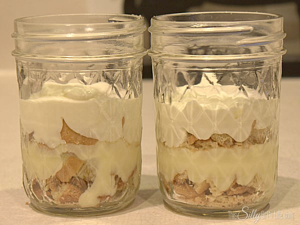 Add another layer of cookies and the banana pudding/whipped topping mixture.