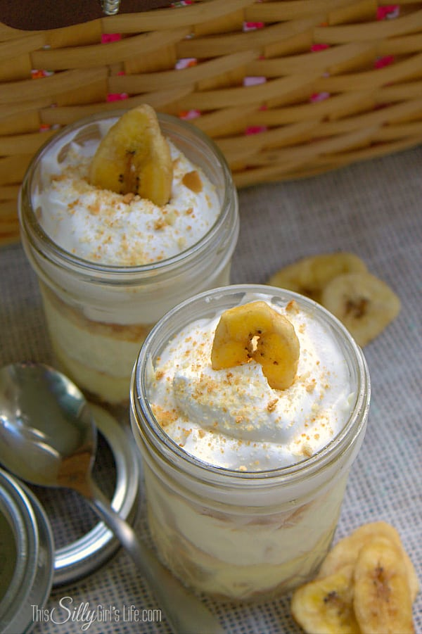 Mini Banana Puddings, layers of banana flavored pudding, crushed vanilla wafers and whipped topping, perfect for a picnic! - ThisSillyGirlsLife.com