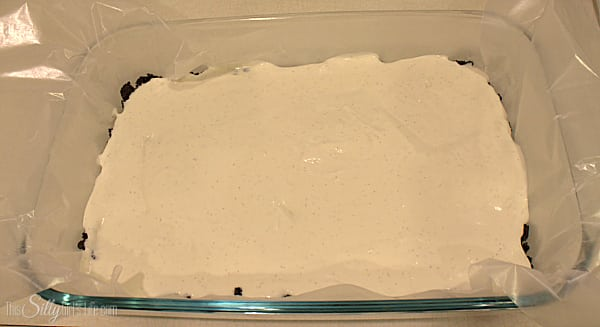 Take the cream cheese and with a hand mixer, cream on high for about a minute. Add in the sweetened condensed milk and vanilla, mix until combined. Fold in the whipped topping. Take half of this mixture and pour over the Oreo crust.
