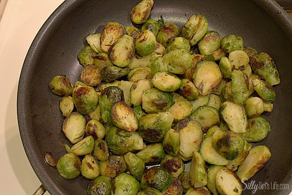 Let brussel sprouts thaw at least half way, slice each brussel sprout in half and set aside. Place diced bacon in a medium sized skillet over medium low heat and cook until crispy, reserving the dripping. Set cooked bacon aside. Keeping 2 tablespoons of the bacon grease in the pan, turn up the heat to medium and cook the brussel sprouts until nicely seared. Don't move them around too much but occasionally stir to make sure they aren't burning.