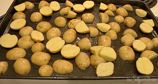 Preheat oven to 425 degrees. Cut potatoes into 1 inch pieces, toss in 2 Tbls olive oil, salt and pepper. Spread on a sheet tray in a single layer