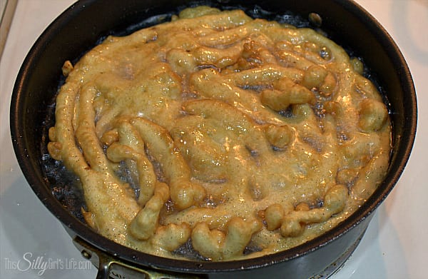 Let fry until golden brown on first side about 3 minutes. With a tongs, turn funnel cake over and let brown on the second side about 2 additional minutes.