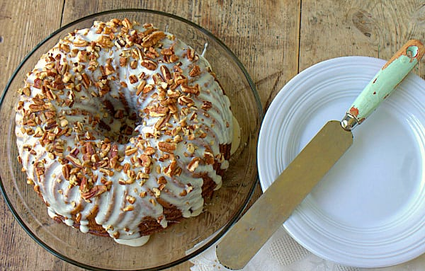 Lightened Hummingbird Bundt Cake, banana pineapple bundt cake topped with cream cheese glaze and garnished with toasted pecans! #InTheRaw