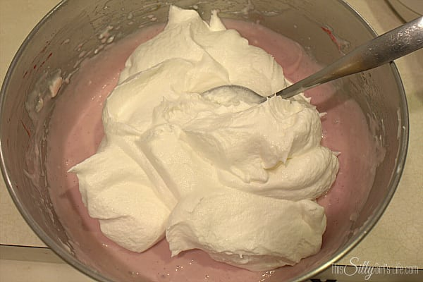 Add in the raspberry puree and carefully on low speed mix in, scraping the bowl if needed. Add in the whipped topping and with a spatula carefully fold it into the mixture until combined. Set aside.