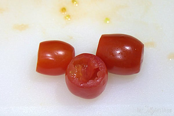 Wash tomatoes and let dry. With a pairing knife, carefully cut the top off at the stem end. On the bottom end, cut a very small piece off so the tomato can stand up and won't tip over. Using a pairing knife, carefully core the inside of the tomato, getting as much of the seeds out that you can but don't pierce all the way through the bottom. Core all tomatoes and set aside.