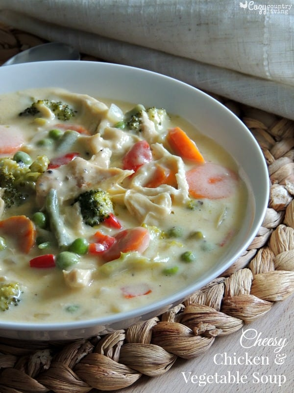 Cheesy Chicken and Vegetable Soup, Tender chicken is mixed with a variety of sauteed vegetables in a creamy Cheddar cheese to give you a warming soup your family will love.