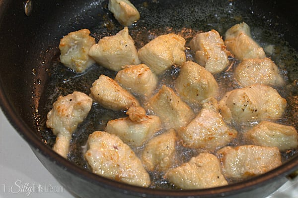 In a skillet with deep sides, add in about 3-4 Tbls of oil, just to coat the bottom of the pan. Heat over medium heat until hot. Place about half of the chicken into the oil, in a single layer and make sure none is touching. Allow this to get brown on all sides, turning over once. This takes about 5-7 minutes. When chicken is cooked through and down, place onto a plate lined with paper towels. Cook the remaining chicken and set aside.