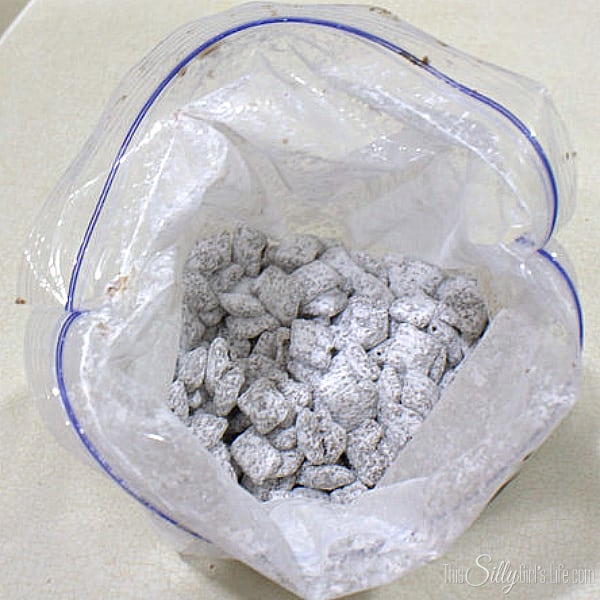 In a small bowl, add the powdered sugar and pumpkin pie spice. Whisk to combine. Add 1/2 Cup of the powdered sugar mix into a gallon sized zip lock bag. Add the chocolate coated cereal into the bag, about 2 cups at a time. Zip the bag and toss until all the cereal is coated. Pour the coated cereal into a large container and keep repeating the process until all the chocolate cereal is coated with powdered sugar.