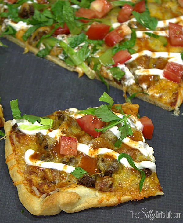 Easy Taco Pizza, two favorites combine to make a delicious, easy meal that's ready in 30 minutes or less! - http://ThisSillyGirlsLife.com