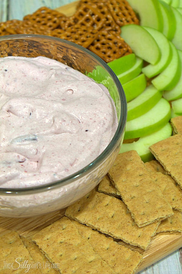 Cranberry Fruit Dip, cream cheese and marshmallow creme blended with cranberries for a festive twist on an already delicious dish! - ThisSillyGirlsLife.com