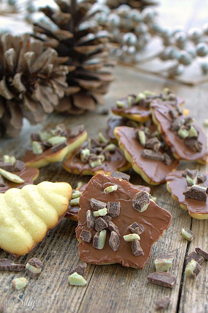 Mint Chocolate Butter Cookies, Italian butter cookies dipped in milk chocolate and topped with Andes mint pieces! - ThisSillyGirlsLife.com #ChristmasCookies