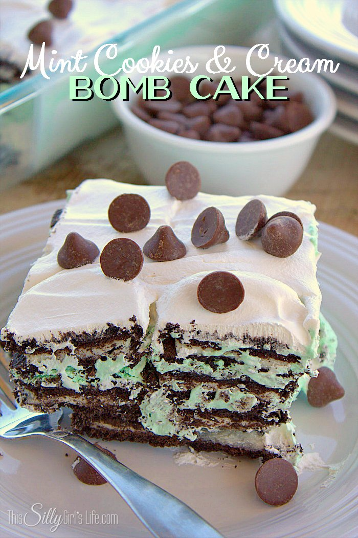 Mint Cookies and Cream Bomb Cake, an easy layered dessert loaded with mint chocolate morsels and Oreos! - ThisSillyGirlsLife.com #TollHouseTime #NestleTollHouse #DelightFulls #sp