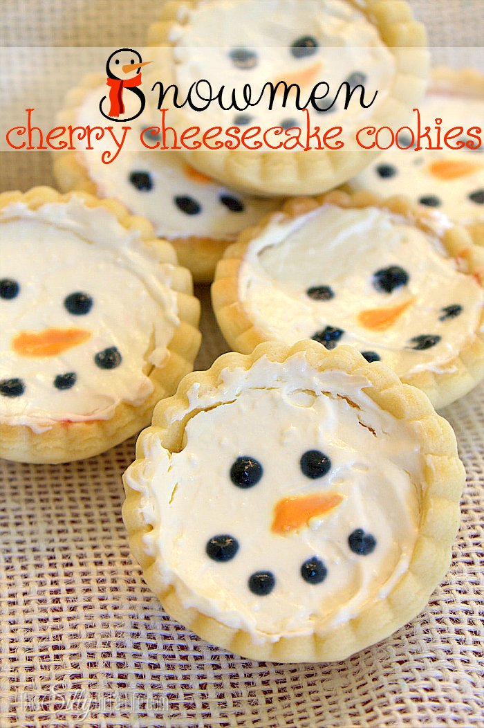 Snowmen Cherry Cheesecake Cookies, cute cookie cups filled with cherry pie filling and no bake cheesecake. Decorated as little snowmen! - ThisSillyGirlsLife.com #TasteTheSeason #ad