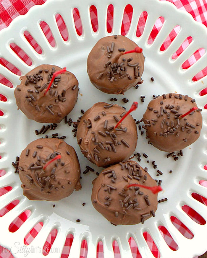 Chocolate Covered Cherry Oreo Cookie Balls, maraschino cherries stuffed inside a classic Oreo cookie ball and dipped in melted chocolate! - ThisSillyGirlsLife.com