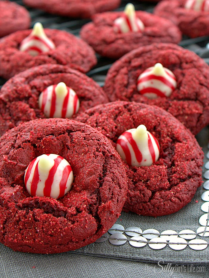 Candy Cane Red Velvet Blossom Cookies, soft and chewy cake mix cookies decorated with candy cane kisses! - ThisSillyGirlsLife.com #BlossomCookies