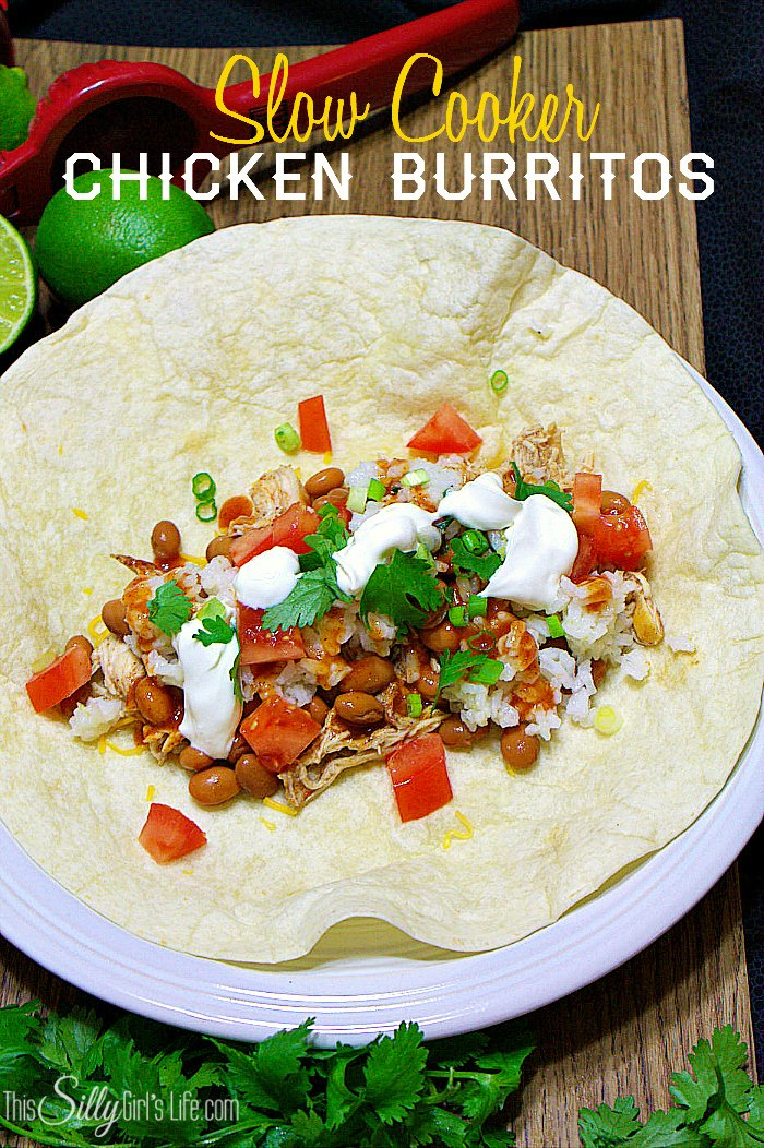 Slow Cooker Chicken Burritos, chicken simmered in Mexican spices until fork tender with pintos and cilantro lime rice, make for one killer healthy burrito! - ThisSillyGirlsLife.com