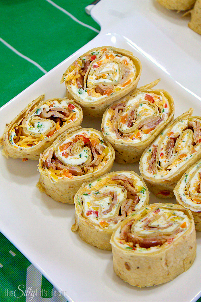 Cheddar Bacon Ranch Pinwheels, tortillas filled with ranch flavored cream cheese, bacon, cheese and more! - ThisSillyGirlsLife.com