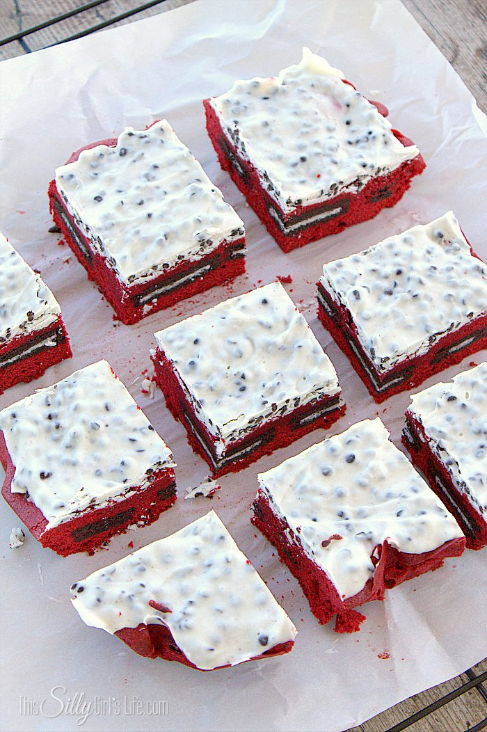 Cookies and Cream Red Velvet Brownies, Oreo stuffed homemade red velvet brownies, topped with cookies and cream kisses! - ThisSillyGirlsLife.com #RedVelvetBrownies