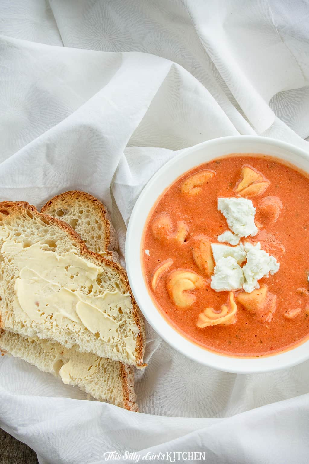 Made with tortellini and goat cheese, this is by far the best tomato soup recipe! #recipe from thissillygirlskitchen.com #slowcooker #crockpot #tomatosoup #soup #tortellinisoup #goatcheese