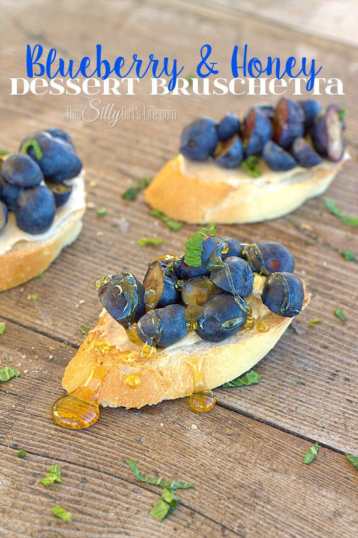 Blueberry and Honey Dessert Bruschetta, toasted French baguette smeared with a honey spread, topped with fresh blueberries and mint with a drizzle of honey. - ThisSillyGirlsLife.com #ButterImprovement #ad