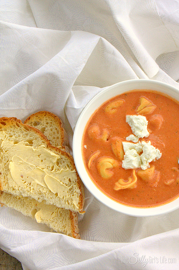 Slow Cooker Tomato Soup with Tortellini and Goat Cheese, a filling creamy soup slow cooked for hours and full of flavor! - ThisSillyGirlsLife.com