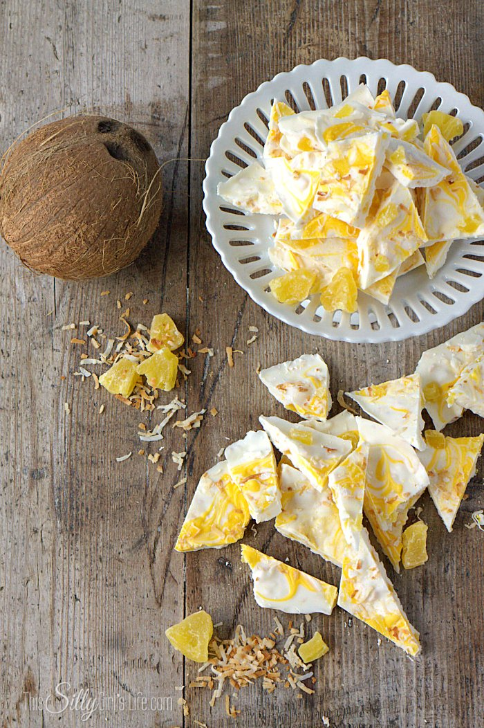 Pina Colada Bark, a delicious and easy candy bark made with toasted coconut and dried pineapple. A tropical escape you can take with you anywhere! - ThisSillyGirlsLife.com #PinaColada