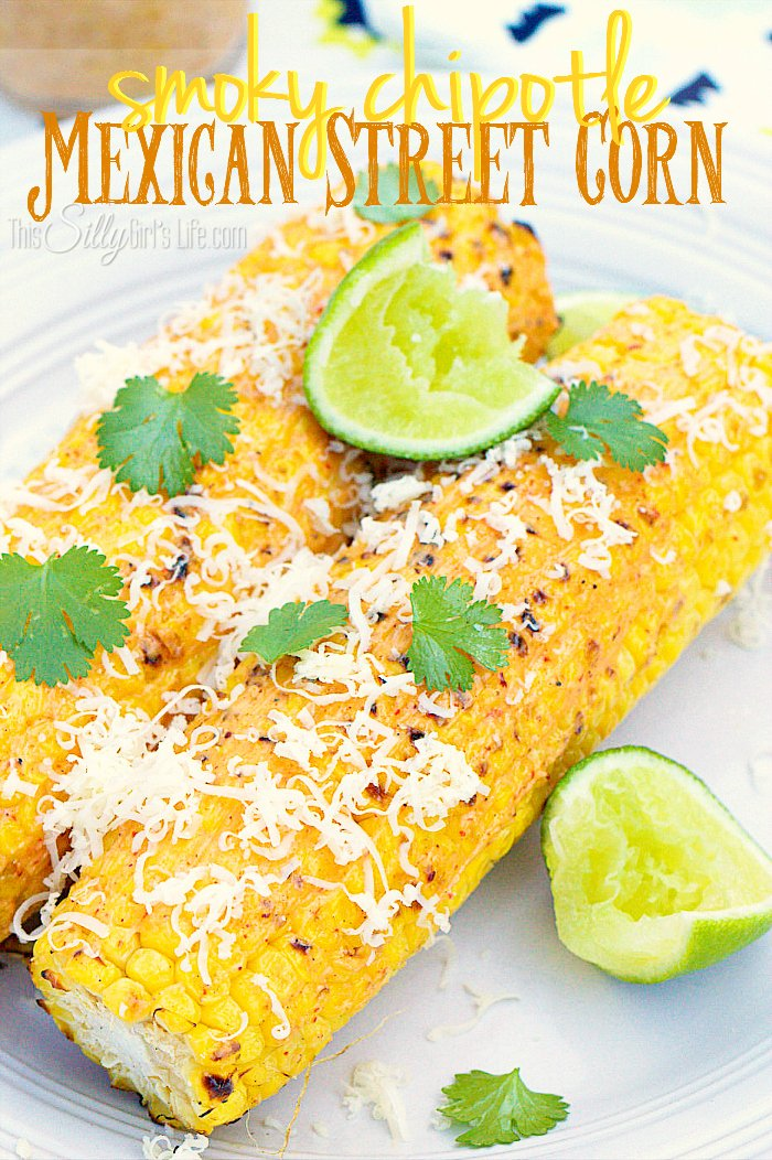 Smoky Chipotle Mexican Street Corn, sweet fresh corn grilled over open flame, smeared with a smoky chipotle mayo. Topped with grated cheese, cilantro and lime! #ad - ThisSillyGirlsLife.com #MexicanStreetCorn