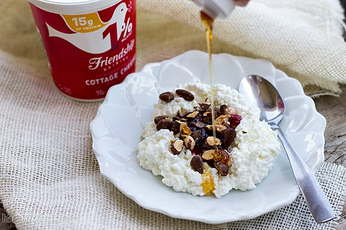 Creamy Raspberry Almond Breakfast Bowl, raspberry curd, cocoa roasted almonds and a drizzle of honey on top a cloud of cottage cheese, perfect for breakfast! - ThisSillyGirlsLife.com #theoriginalsuperfood #ad