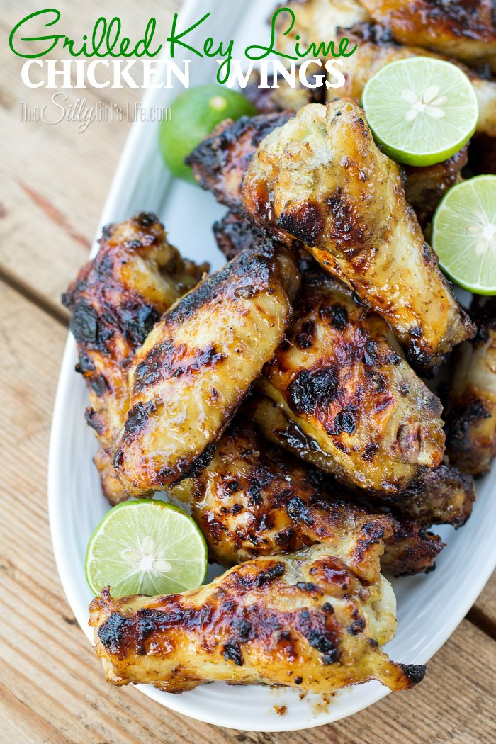 Grilled Key Lime Chicken Wings, marinaded for hours in a sweet, herbaceous marinade with a hint of key lime, then grilled to caramelized perfection! Plus video tutorial. - ThisSillyGirlsLife.com #chickenwings #gilling #keylime