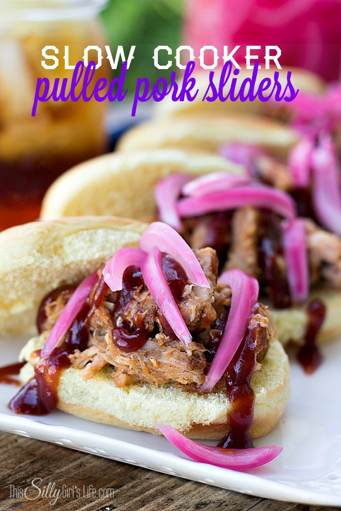 Slow Cooker Pulled Pork Sliders, pork loin rubbed in spices and slow cooked until fork tender, served with bbq sauce and pickled onions! - ThisSillyGirlsLife.com #sliders #pulledpork #appetizer