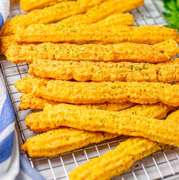 Square image of Cheese Straws on wire rack