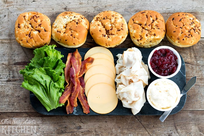 Ultimate Turkey Bacon Cranberry Sandwich, an amazing sandwich on a toasted onion roll, featuring cranberry sauce, smoked Gouda, turkey and of course, BACON... perfect for game day! from ThisSillyGirlsLife.com #CBCTailgating #tailgatingrecipes #homegating #tailgating #ad