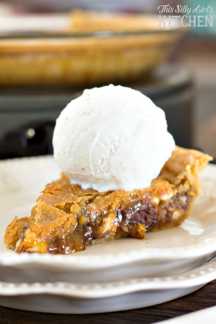 Double Chocolate Chip Cookie Pie, ooey gooey deliciousness. Even better topped with ice cream! from ThisSillyGirlsLife.com #chocolatechipcookie #cookiepie #christmascookie