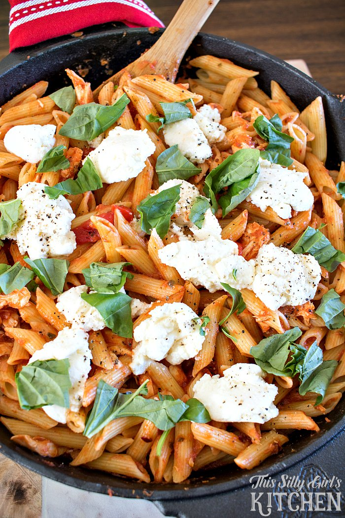 Creamy Chicken Fra Diavolo, rotisserie chicken, basil and dollops of ricotta in a spicy tomato sauce with penne make this a show-stopping weeknight meal! from ThisSillyGirlsLife.com #BarillaOrganic #BarillaMarinara #ad