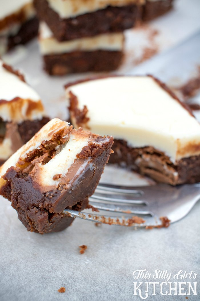 White Chocolate Truffle Stuffed Brownies, irresistible fudgy brownies stuffed with truffles and topped with a thick layer of white chocolate ganache, a chocolate lover's dream! from ThisSillyGirlsLife.com #stuffedbrownies