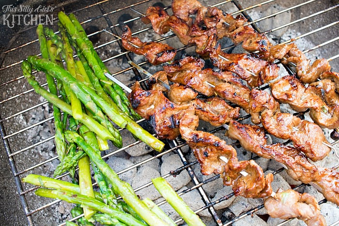 Asian Steak Skewers, flank steak sliced thinly, marinated in a hoisin sauce, skewered and grilled over charcoal! Super tender and extremely flavorful. from ThisSillyGirlsLife.com #KingsfordProfessional #ad
