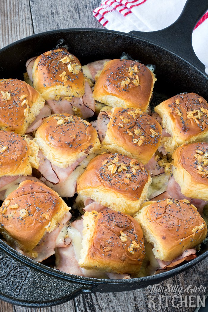 Cast Iron Baked Ham and Swiss Sliders, bursting with flavor, these party sliders are baked in a cast iron skillet and drizzled with a savory butter sauce! from ThisSillyGirlsLife.com @KingsHawaiian #ad
