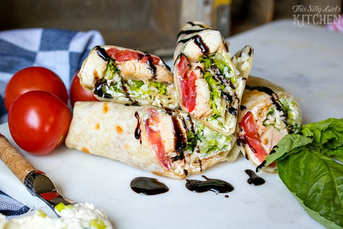 Caprese Chicken Wraps, grilled chicken, mozzarella, basil and tomatoes wrapped in a warm flour tortilla and drizzled with balsamic glaze. from ThisSillyGirlsLife.com #SummerGoodness #ad