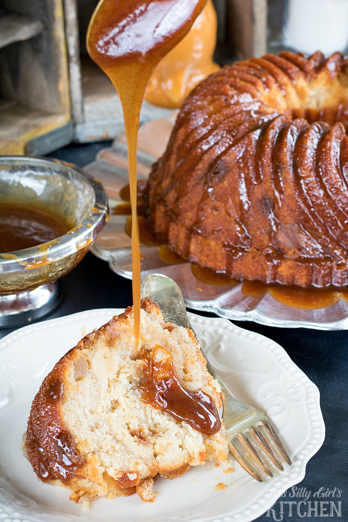 Caramel Apple Cheesecake Filled Butter Cake, classic Kentucky butter cake gets turned up with a cheescake filling, bits of apple throughout and topped with cinnamon caramel sauce. from ThisSillyGirlsKitchen.com