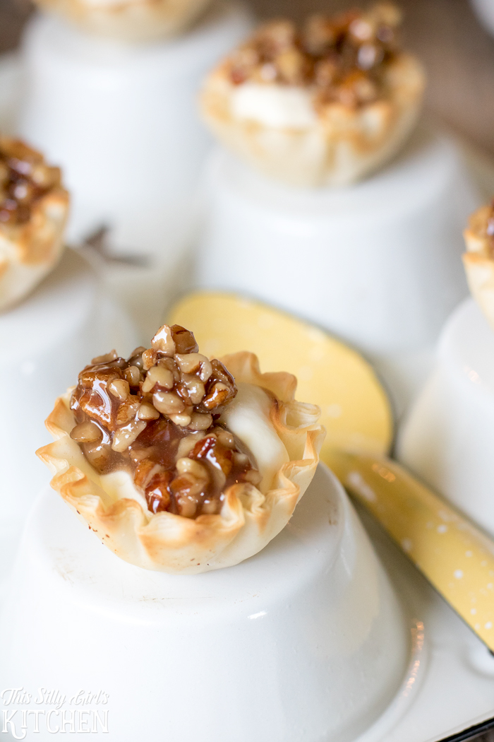 Creamy Baklava Bites, phyllo cups, flavored whipped cream and honey glazed pecans make for a fun twist on a classic dessert. from ThisSillyGirlsKitchen.com #ad #BuzznBloom